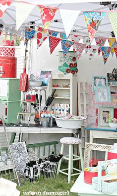 colorful booth display ~ love the bright bunting. Good way to decorate craft booth.