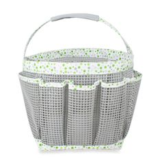 """Mesh Shower Tote - Green Dot  This stylish tote allows you to carry all your shower needs, including soap, razor, shampoo, body wash, creams, towel, hairbrush and more. Tote features a spacious center compartment, two large side pockets, three smaller pockets on front, and three smaller pockets on back, plus a carry handle. The tote is made of rubberized mesh, so it's ideal for the shower or bath. Measures 7"""" H x 15"""" W x 9"""" D."""