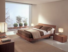 ICARO - Bed in walnut finishing and bed system Babele. http://www.fimarmobili.com