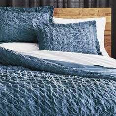 Refresh your bedroom with modern duvet covers and inserts. Find chic bedding in contemporary patterns, colors and textures.