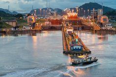 PanamaCanalTransit - Exiting Miraflores locks at dusk.