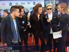Niall looks so beyond nervous it cracks me up.
