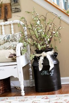Ok, found a milk jug like this at a thrift store! Use it in foyer or on porch???
