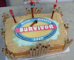 """Suvivor Cake - My husband's work did a """"Survivor"""" themed team building event and this was the cake that I did. One layer of the cake was French Vanilla and the other a chocolate of some sort with a Boston cream filling between the layers then all covered in BC. The survivor logo is a combo of gumpaste and MMF. The torches and flames are gumpaste. The fence is pirouettes Thanks for looking."""