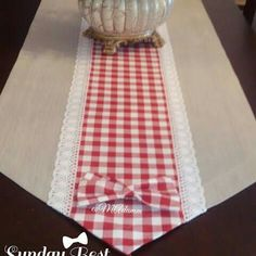 [I like the pointed ends of this table runner.]