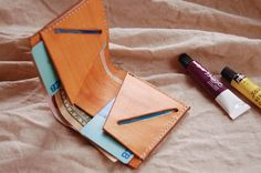 Leather Crafts by UnimiStore are Hand sewn veg leather items like wallet pack bag business card holder portfolio accessories perfect leather gift for men women boyfriend girlfriend, very fashionable, minimalist and unique