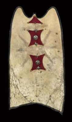 Africa | Shield ~ ahrer or arar ~ from the Tuareg people of the Aïr region in Niger | Oryx antelope skin, silver, copper, red fabric