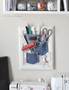 DIY jeans pocket framed wall storage organizer - I'd to do this in a larger version with corkboard behind the fabric
