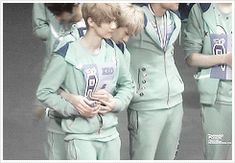 Hunhan-Sehun gently guiding Luhan's hand back