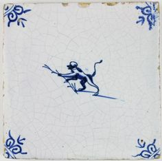 Antique Dutch Delft tile in blue with a monkey holding a twig, 17th century