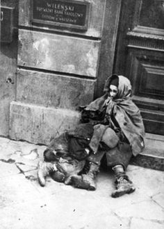 Warsaw, Poland, Two hungry children at the entrance to the Wilenski Bank, 1942.