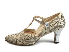 Grey geometric patterned brocade shoes, decorated with silver leather appliqué, 1920's.