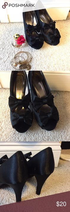 "Black double bow peep-toe heels Super cute double peep-toe heels from Xhilaration. Used Madden Girl for exposure. They have never been worn outside, only inside for a few hours. They are in perfect condition! Great got the holidays! Heel is about 4"" Madden Girl Shoes Heels"
