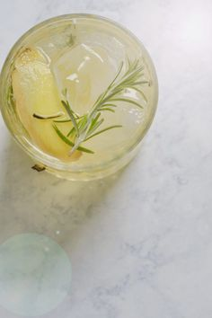 This ginger gin cocktail is a clean summer cocktail featuring Rosemary, Lemon, Ginger and Gin. Easy to make with pantry ingredients!