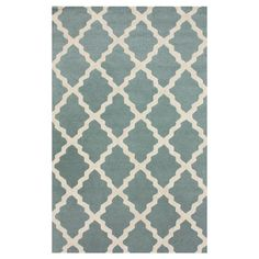 Anchor your living room or den with this handmade wool rug, showcasing a trellis motif in spa blue.  Product: RugCon...