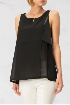 Leatherette Top is a great go-to for a night out. A leather and sheer detail on the left side dresses up a basic black top.   Leatherette Top by HYFVE. Clothing - Tops - Sleeveless Branford, Connecticut