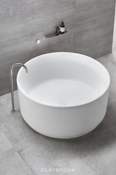 If you're looking for a minimalist bathroom design, our round bathtub The Orbit is perfect. Big enough for two bathers, you are sure to have a relaxing soak. For unique bathroom design ideas, this is just the thing! Immerse yourself in the Orbit bath for a truly zen-line bathing experience. #modernbathroom #minimalistbathroom #roundbathtub