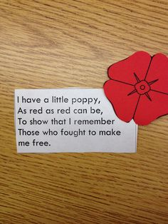 "Veterans Day Poem (no link, just photo; ""I have a little poppy, as red as red can be, to show that I remember those who fought to make me free."")"