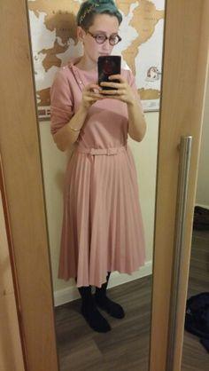 We love Angharad's pink dress