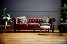 LETTUCE & CO - STYLE. EAT. PLAY 'viv + lachy - modern art deco'. guest lounge chill out zone. chesterfield leather couch. velvet chairs. magnolia. fig leaf tree. geo scatter cushions. wedding reception @ northcote town hall. concept, design and wedding styling by lettuce & co