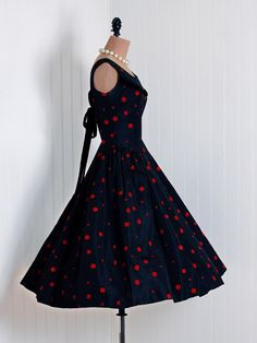 I want this!! 1950's vintage polka dot dress. The 50's had great clothes. And I have a 50's style bod.