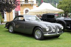"""What better place than the lawns of Villa d'Este to show an Alfa Romeo 6C 2500 - Villa d'Este? This model, one of 36 examples, is the last handmade Alfa Romeos, and is named for the Villa d""""Este Concours where it won an award."""