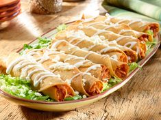 """When tacos are rolled tightly and pan-fried until crisp so they resemble tubes or """"flutes,"""" they become flautas. Enjoy these tasty Chicken Flautas! Add spinach and queso to top Mexican Dishes, Mexican Food Recipes, Snack Recipes, Cooking Recipes, Ethnic Recipes, Easy Recipes, Mexican Cooking, Kitchen Recipes, Dinner Recipes"""