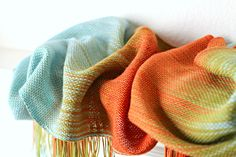 Hand woven scarf gradient color blue, red and orange long with fringe. $85.00, via Etsy.