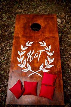 Wedding cocktail hour idea - personalized corn hole board {Alisa Sue Photography}