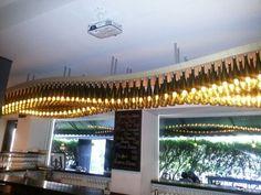 The wine bottle chandelier @vinotecabysula