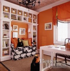 Sophisticated office space with a whole lot of character and style. The vibrant orange used in this space as well keeps it warm and inviting.