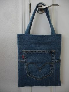 To make this fun tote, salvage an old and worn pair of your jeans or purchase an inexpensive pair at your favorite thrift shop. Use the existing pockets for the exterior pocket and for a hanging pocket on the inside–for your phone and other small essentials. This tote is the perfect size if you prefer a small purse or it makes a great book bag to carry your favorite book or e-reader. It's also a nice size for a bag for your tween or teen.