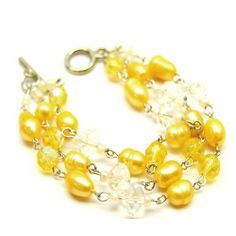 Multistrand Yellow Pearl and Crystal Beaded Toggle Bracelet TrinketCentral. $16.95. Sunny yellow color hues.. Versatile - can be worn day or evening.. Easy to wear with toggle closure.. Fashionable multistrand design.