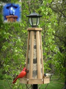 Solar-Powered Lighthouse Bird Feeder, Solar Lighthouse Bird Feeder, Solar Bird Feeders at Songbird Garden Unique Bird Feeders, Wooden Bird Feeders, Bird House Feeder, Bird Suet, Solar Powered Yard Lights, Solar Lights, Bird Houses For Sale, Solar Lighthouse, Bird Boxes