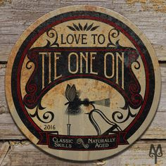 Tie One On, fly tying, vintage, decorative metal wall sign made by Montana Treasures in Bozeman, Montana. Shop now!