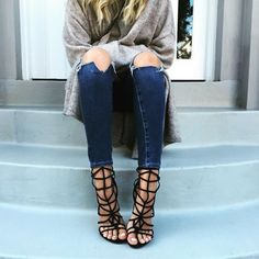 Strappy shoes + ripped denim. Elle Ferguson, Strappy Shoes, Caged Sandals, Caged Heels, Gladiator Sandals, All Jeans, Vogue, Ripped Denim, Dress Sandals