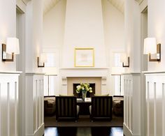 sconces in front entry instead of a light fixture hanging two stories up