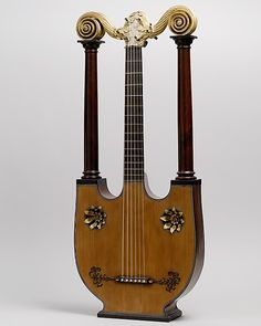 Lyre Guitar Pons fils Date: ca. 1805 Geography: Paris, France Medium: Mahogany, spruce, gilding. http://www.pinterest.com/TheHitman14/music-instruments/