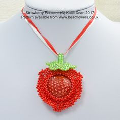 This strawberry pendant beading pattern shows you how to bead around a Cabochon from L2 Studios, then turn it into a strawberry. Intermediate and beyond.