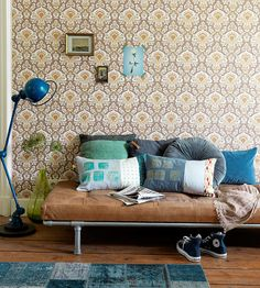We adore those pillows. And the wallpaper. And the lamp. Heck, even the sneakers.
