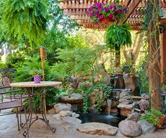Under the protection of a pergola, the Langes added a second small pond and waterfall. Its central location near several garden rooms means they can enjoy the sound of the waterfall from more than one seating area.