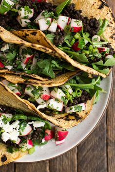 Easy vegetarian spicy lentil tacos made with a custom spice blend and topped with homemade radish salsa, feta, and a squeeze of fresh lemon juice.