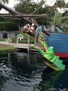 The gator actually comes out of the water trying to get the pirate at Captain Hook's Adventure Golf!