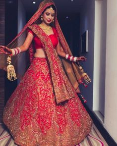 Pair this red and gold bridal lehenga covered with beautiful and rich zardozi art work with an intricate bib styled gold necklace set crafted with studded diamonds from #SanginiDiamondJewellery for an understated and subtle style statement.