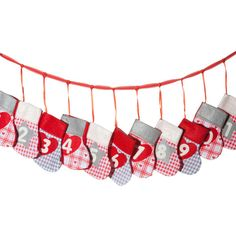 Your Christmas routine is so old you can deck the halls in your sleep. Mix things up with the Stocking Advent Garland it rolls two timeless traditions into one...