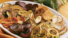 For weeknight meals, you can speed up the process of roasting winter vegetables by cutting them into thin slices. For a medley like this one, roast the different vegetables on separate baking sheets, so each one gets the right amount of cooking time. Different Vegetables, Fruits And Veggies, Root Veggies, Wine Recipes, Cooking Recipes, Cooking Time, Roasted Winter Vegetables, Zucchini, Food & Wine Magazine