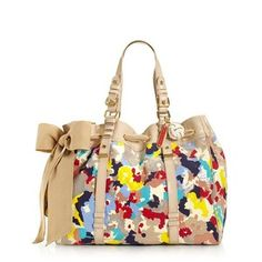 love this purse cute and summery I used this over spring break and loved it got a lot of comments on it and it  holds all my stuff that couldn't fit in the last purse I used that purse is not out yet so I cant show you sry