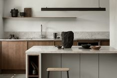 Nordic Archipelago by Nordiska Kök. A dark oak frame kitchen with hidden handles creates a warm and rustic feel in this Nordic archipelago inspired minimalist kitchen. The steel countertop, the kitchen island in light gray with Gotland limestone creates a Minimalist Kitchen Interiors, Minimalist Home Decor, Minimalist Style, Minimalist Bedroom, Minimalistic Kitchen, Minimalist Interior, Minimalist Design, Minimal Kitchen Design, Minimalist Living