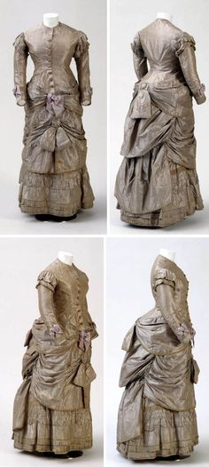 Party dress with bustle ca. 1882. Purple & cream-colored silk with white cotton lining. Wooden buttons. German National Museum
