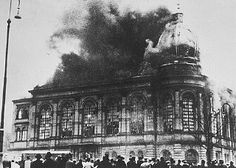 """Synagogue in flames. Reichskristallnacht (Night of the broken glass) or Kristallnacht """"Crystal Night"""", aka the Night of Broken Glass,  was a pogrom (a series of coordinated attacks) against Jews throughout Nazi Germany and parts of Austria on 9–10 November 1938, carried out by SA paramilitary forces and non-Jewish civilians. German authorities looked on without intervening."""